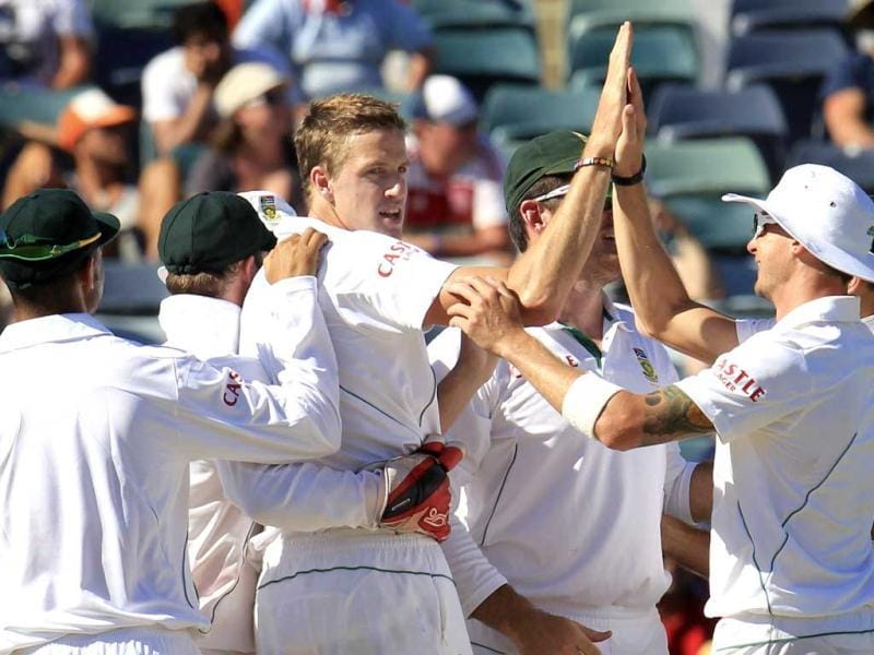 Team mates congratulate South Africa's Morne Morkel (C) for taking the wicket of Australia's John Hastings at the WACA in Perth during the fourth day's play of the third cricket test match. Reuters Photo