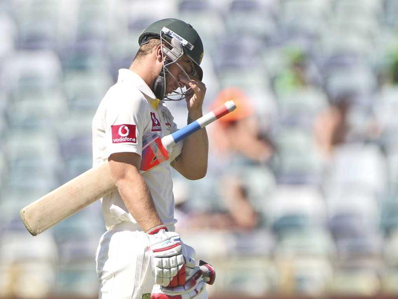 Australia's Matthew Wade reacts after South Africa's captain Graeme Smith caught him out on day four of the third cricket test match in Perth, Australia. AP Photo