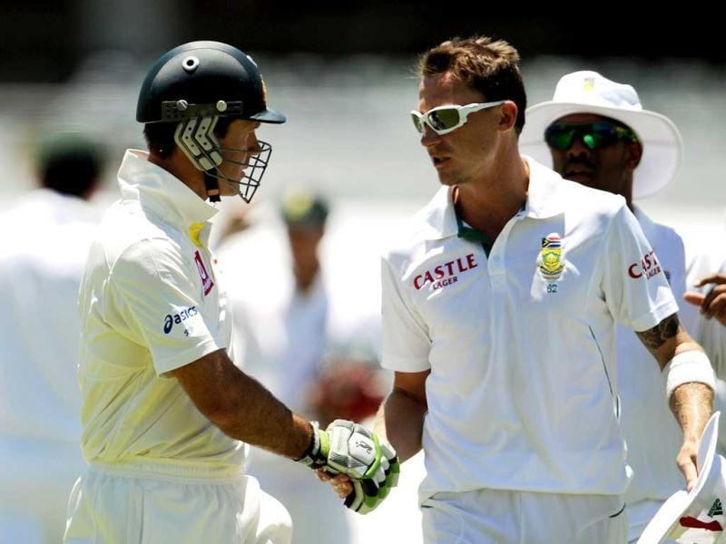 Australia's batsman Ricky Ponting shakes hands with South Africa's Dale Steyn as he leaves the field after being dismissed for 8 runs at the WACA ground in Perth. AFP Photo