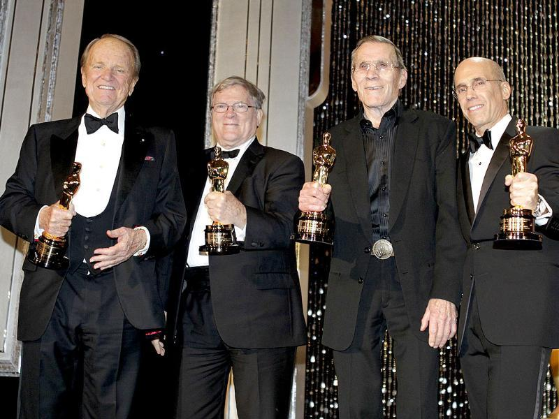 Honorary Oscar recipients George Stevens, DA Pennebaker, Hal Needham and Jeffrey Katzenberg pose on stage at the conclusion of the Academy of Motion Picture Arts & Sciences 4th annual Governors Awards in Hollywood. Reuters/Fred Prouser