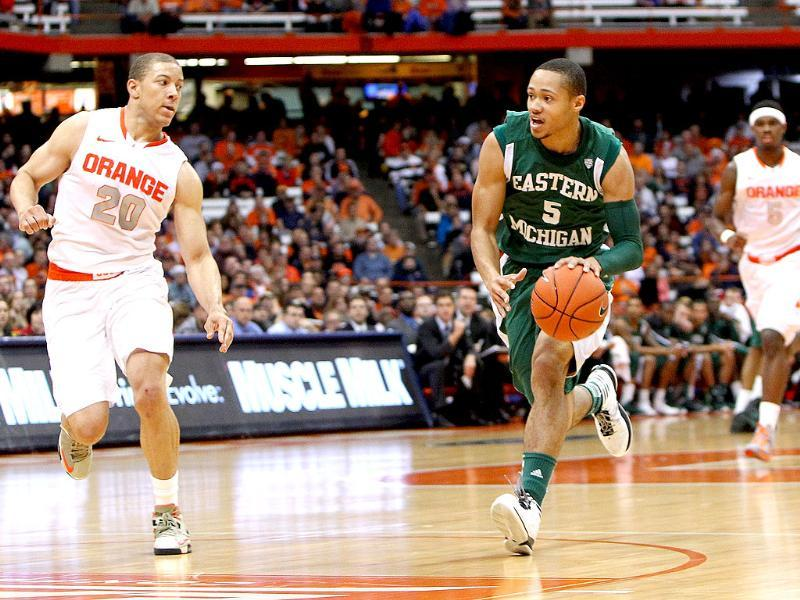 Derek Thompson #5 of the Eastern Michigan Eagles drives to the basket against Brandon Triche #20 of the Syracuse Orange during the game at the Carrier Dome in Syracuse, New York. AFP/Nate Shron/Getty Images