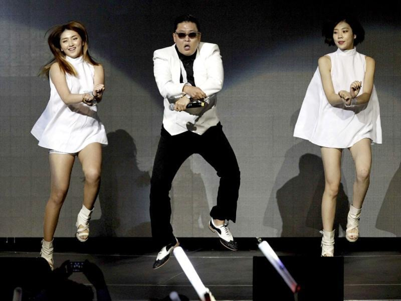 South Koreon rapper Psy wows fans as he performs the signature horse-riding dance during KIIS FM's Jingle Ball concert in Los Angeles, California. (Reuters/Mario Anzuoni)