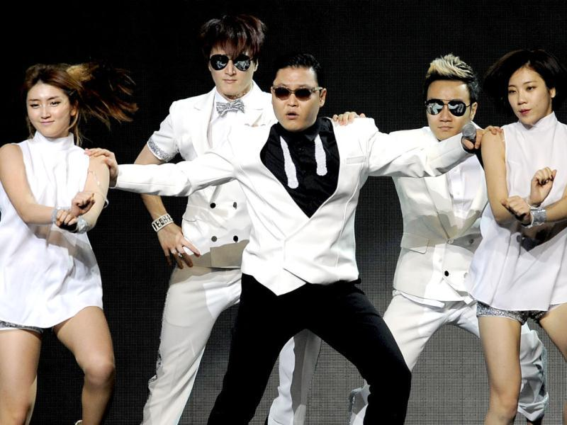 Psy performs with backup dancers during the second night of KIIS FM's Jingle Ball at Nokia Theatre LA in Los Angeles. (AP)
