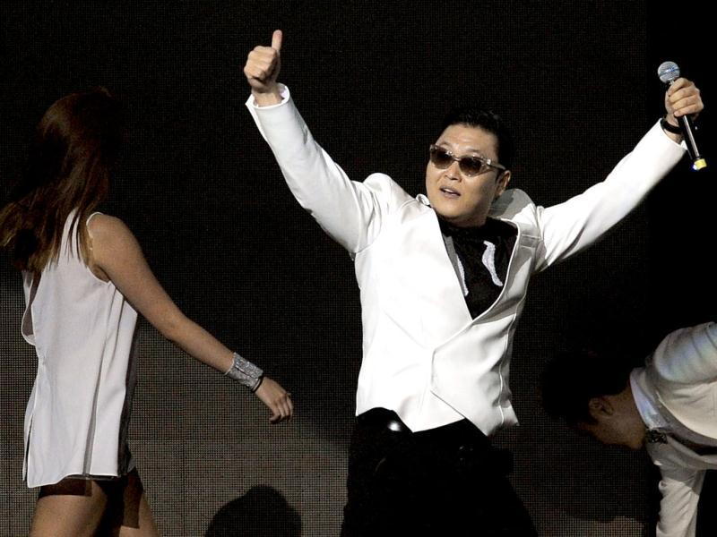 Psy gestures to the crowd following his performance on the second night of KIIS FM's Jingle Ball at Nokia Theatre LA Live in Los Angeles. (AP)