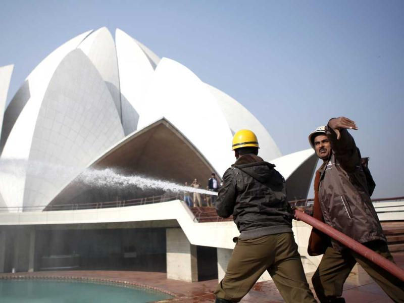 A fire fighter participating in a mock drill in Lotus Temple in New Delhi. HT/M Zhazo