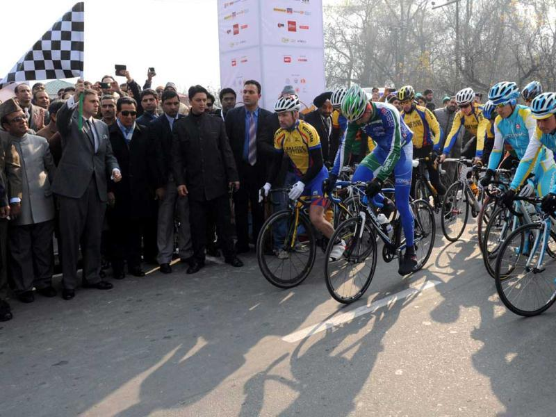 Chief minister of Jammu and Kashmir Omar Abdullah flags off the peleton of riders as they start the second leg of the Tour de India in Srinagar. It is the first ever international cycling race held in India. AFP