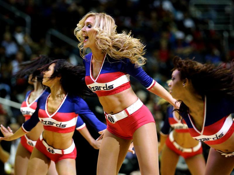 Members of the Washington Wizards Girls preform during the Wizards and Miami Heat game at Verizon Center in Washington, DC. AFP/Rob Carr/Getty Images
