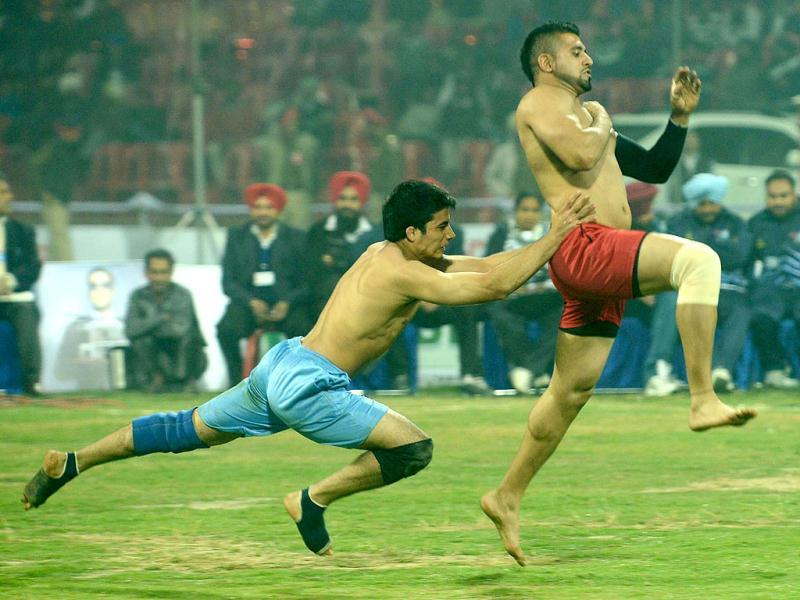 Argentina kabaddi player (L) tackles his US opponent during the 3rd Pearls World Cup Kabaddi Punjab-2012 tournament at Guru Nanak Stadium in Amritsar. US won the match with a score of 77-14. AFP PHOTO