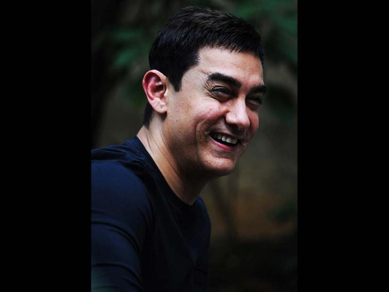 Contagious laugh: Aamir Khan finds something rather humourous at the press conference.