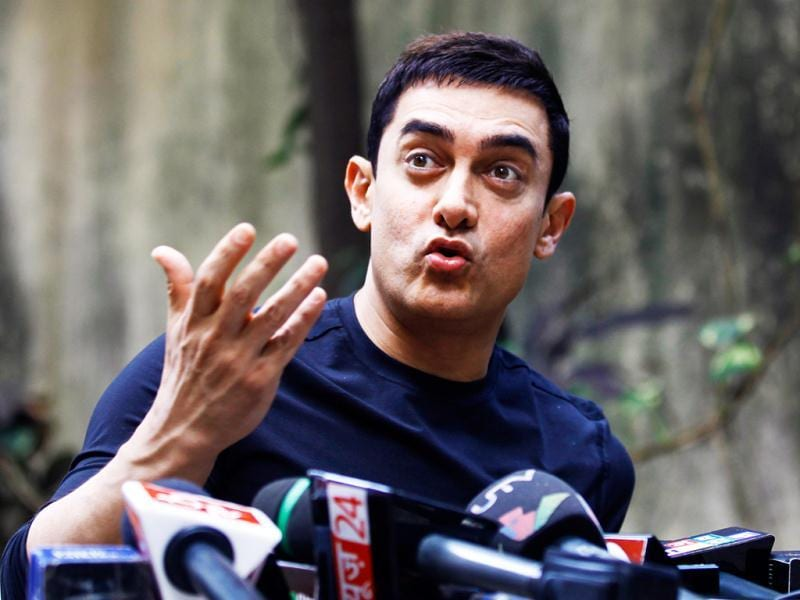 Aamir Khan has an amused look as he talks to the media during Talaash promotions at his residence.