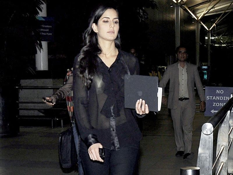 Katrina Kaif was caught at the airport by the paparazzi in a see-through black top with the ruffly lapel as she stepped out that way to board a flight from Mumbai to Delhi on Tuesday. The light bounced off her shimmery lingerie, giving passers by quite a view. (Photo/Yogen Shah)
