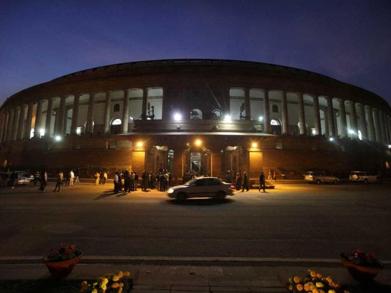 An official's car drives past Parliament House in New Delhi. Congress led government won a crucial vote in favor of its decision to open up the country's huge retail sector to foreign big-box companies like Wal-Mart, a move that its opponents said will crush small shop owners and farmers. (AP Photo)