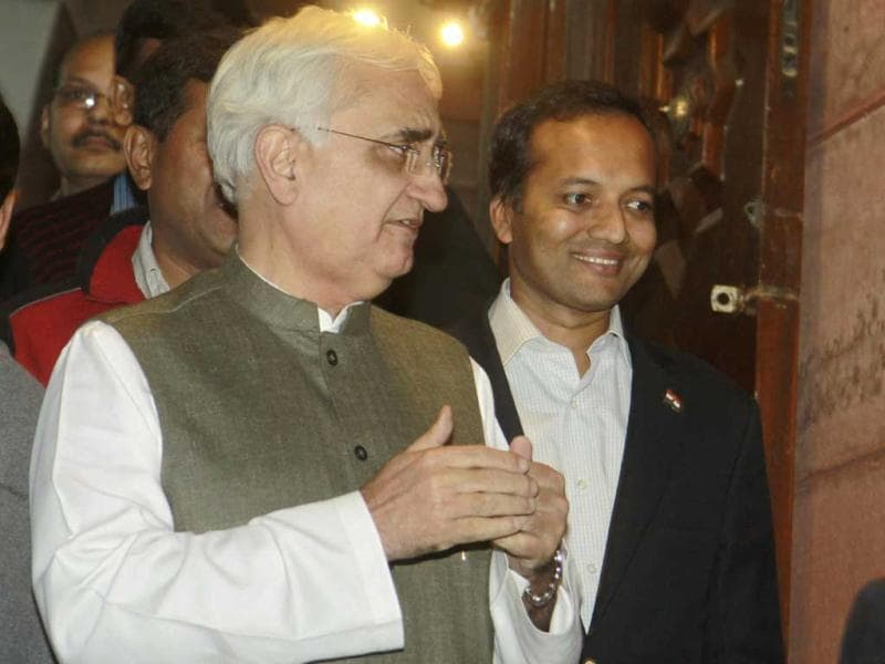 Minister of external affairs Salman Khurshid and Congress MP Naveen Jindal leave Parliament after winning a vote on foreign direct investment. (HT Photo/Sonu Mehta)