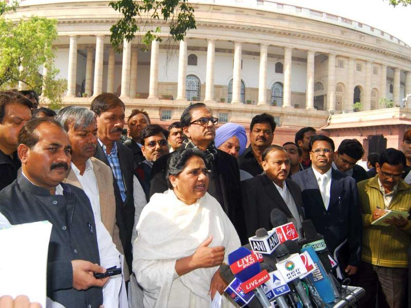 Bahujan Samaj Party supremo Mayawati along with party MPs talk to reporters at Parliament House in New Delhi. (Agencies)