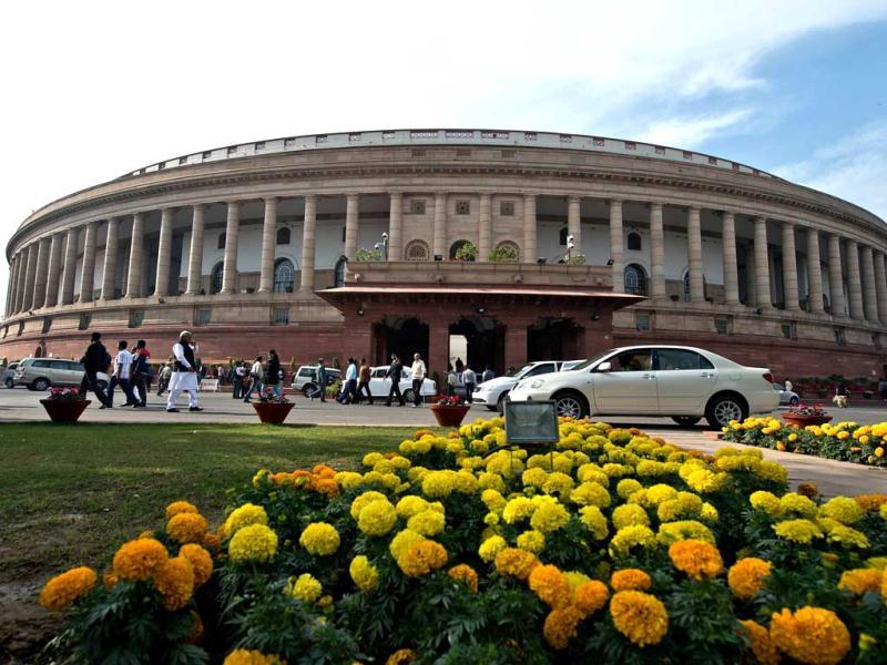 Parliamentarians leave Parliament House during the winter session in New Delhi. (AFP Photo)