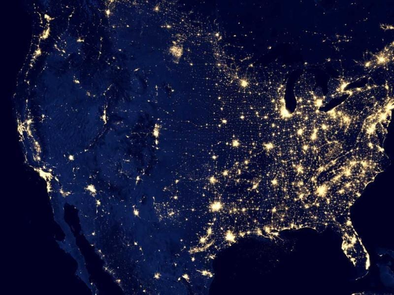 "This NASA image shows the United States at night. The image was made possible by the new satellite's ""day-night band"" of the Visible Infrared Imaging Radiometer Suite (VIIRS), which detects light in a range of wavelengths from green to near-infrared and uses filtering techniques to observe dim signals such as city lights, gas flares, auroras, wildfires, and reflected moonlight. (AP Photo/NASA)"