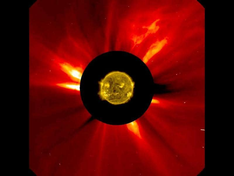 A combined NASA handout image shows the sun's innermost atmosphere as seen by the Solar Dynamics Observatory (SDO) inside a larger image provided by the Solar and Heliospheric Observatory spacecraft (SOHO) taken November 8-9, 2012. A coronal mass ejection can be seen traveling away from the sun in the upper right corner. (Reuters/ NASA)