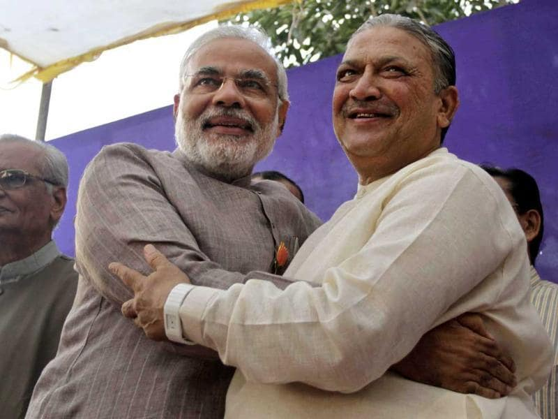 Gujarat chief minister and Bharatiya Janata Party (BJP) leader Narendra Modi poses with former deputy chief minister and Congress party leader Narhari Amin, after Amin joined the BJP in Ahmedabad. AP Photo/Ajit Solanki