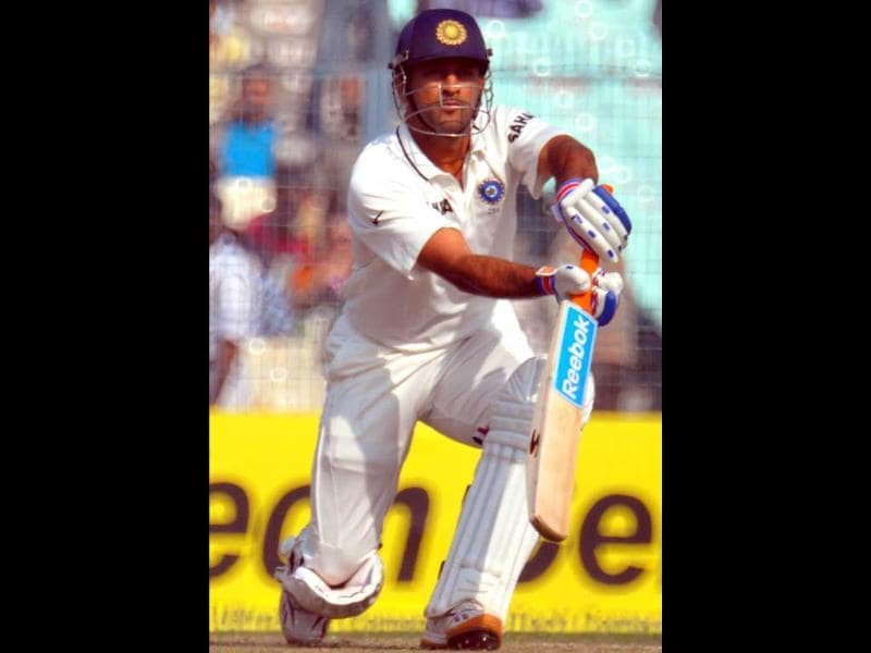 M S Dhoni hits a shot during Day 2 of the 3rd India-England Cricket Test at Eden Gardens in Kolkata . Agencies
