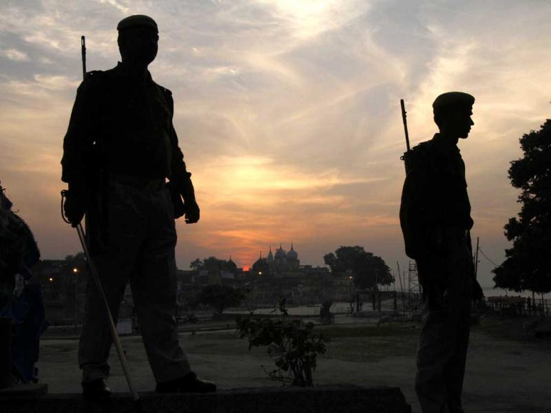 Policemen silhouetted during sunset stand guard near a mosque on the 20th anniversary of the Babri mosque demolition in Ayodhya. AP Photo