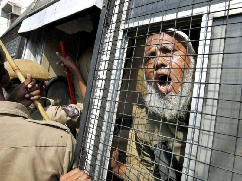 A Muslim activist of Darsgah-Jihad-O-Shahadat (DJS) shouts slogans from inside a police van after he was detained during a protest in Hyderabad on the 20th anniversary of the Babri mosque demolition. AP Photo
