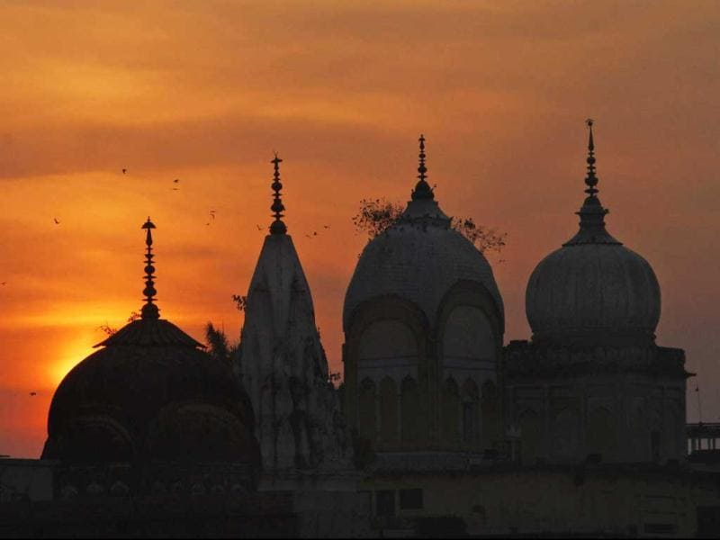 Birds fly at sunset over a Hindu temple on the 20th anniversary of the Babri mosque demolition in Ayodhya. AP Photo