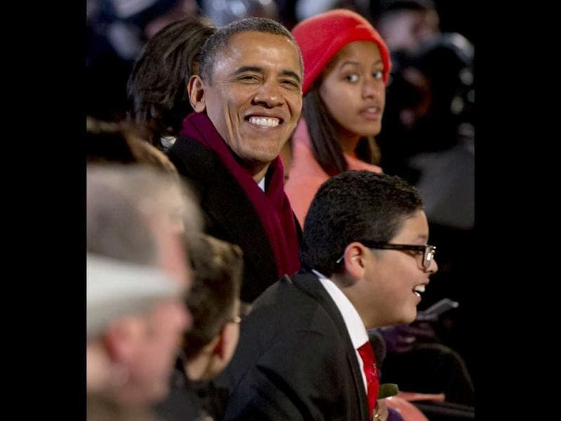 US President Barack Obama and his daughter Sasha (top) sit alongside actor Rico Rodriguez (bottom R) from the televison show