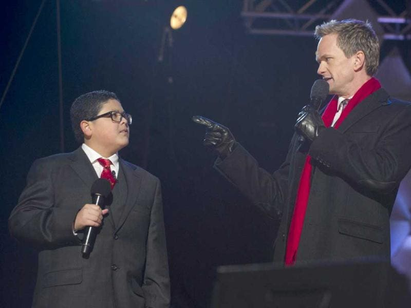 Actor Neil Patrick Harris speaks with actor Rico Rodriguez (L) from the televison show
