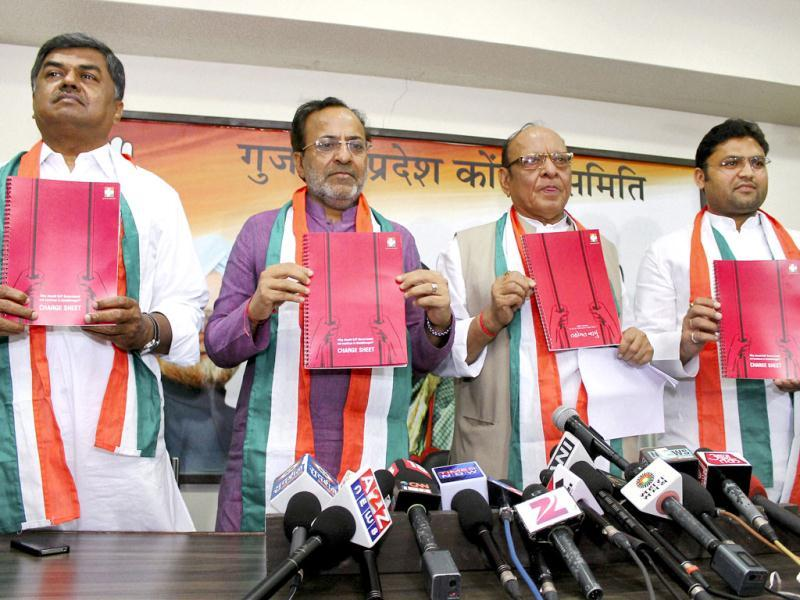 Gujarat Congress incharge B.K. Hariprasad with party leaders Arjun Modhwadia, Shankarsingh Vaghela and Ashok Tanwar release the party's chargesheet against chief minister Narendra Modi and his government at a press conference in Ahmedabad. (PTI Photo)