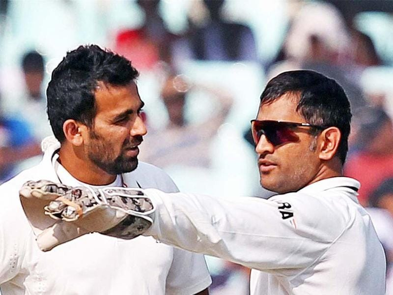 Captain MS Dhoni and Zaheer Khan during Day 3 of the 3rd Cricket Test Match against England at Eden Garden in Kolkata. PTI