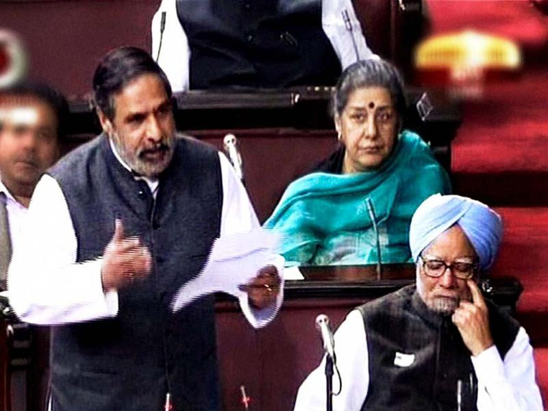 Commerce and industry minister Anand Sharma speaks during the debate on FDI in Rajya Sabha in New Delhi. Prime Minister Manmohan Singh is also seen. PTI/TV grab