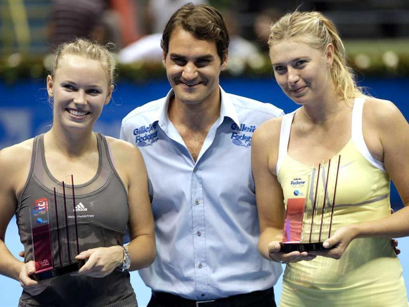 Caroline Wozniacki and Maria Sharapova pose for pictures with Roger Federer after a Gillette Federer Tour exhibition match in Sao Paulo. AP Photo