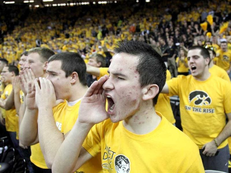 Iowa Hawkeyes fans cheer against the Iowa State Cyclones at Carver-Hawkeye Arena in Iowa City, Iowa. Iowa defeated Iowa State 80-71. AFP