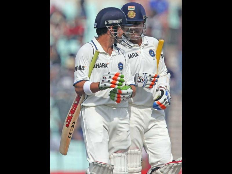 Virender Sehwag and Gautam Gambhir walk off the field after the end of the first session during Day 4 of the 3rd Test Match against England at Eden Garden in Kolkata. PTI Photo