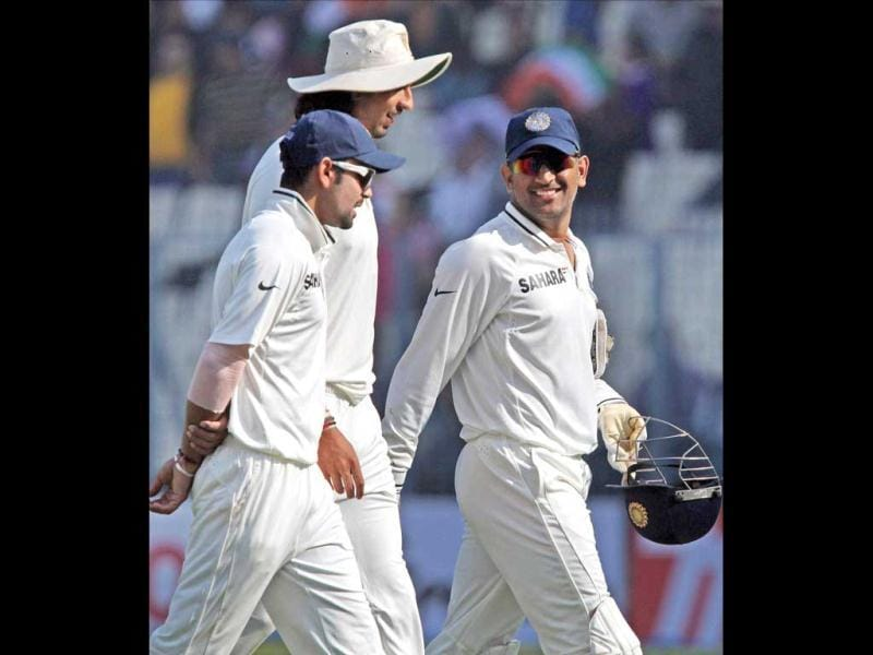 MS Dhoni shares a light moment with his teammates Ishant Sharma and Virat Kohli as they walk off the field after bowling out England team during 4th day of 3rd Test Match at Eden Garden in Kolkata. PTI Photo