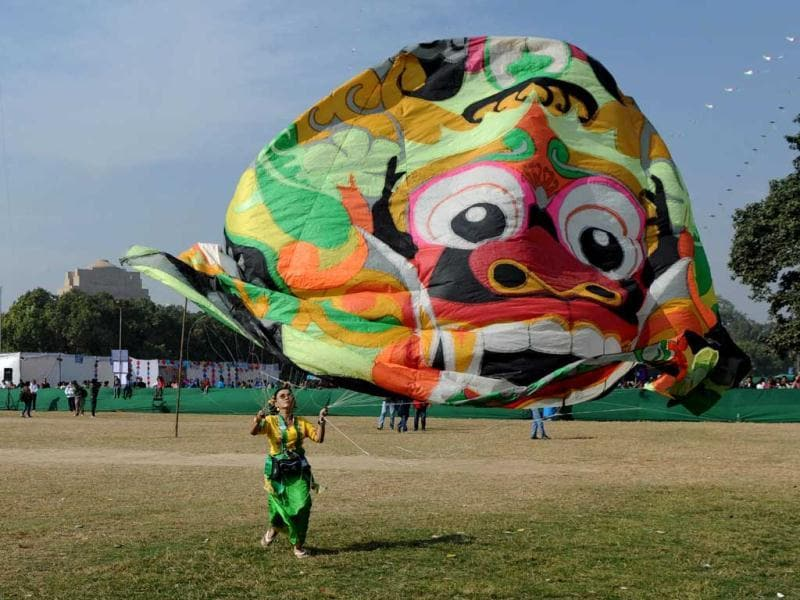A visitor launches a kite during the Delhi International Kite Festival.The event, organised by Delhi Tourism, is being held in the Indian capital for two days. (AFP Photo)
