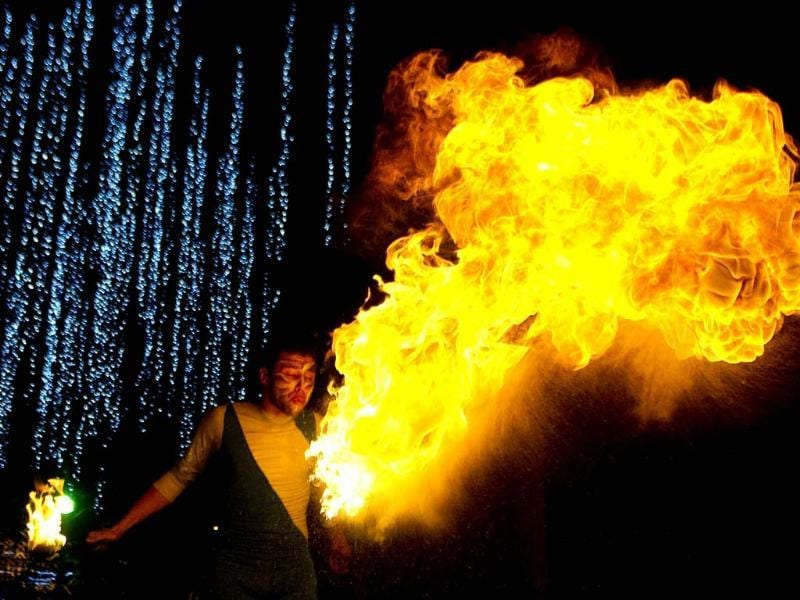 An actor performs with fire during