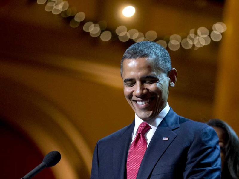 President Barack Obama smiles as he delivers his remarks during the Annual Christmas in Washington presentation at the National Building Museum in Washington. AP Photo