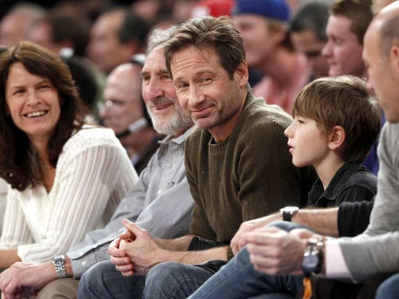 Actor David Duchovny attends an NBA basketball game between the New York Knicks and the Denver Nuggets in New York. AP Photo