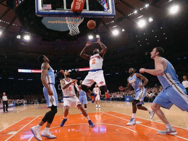 Raymond Felton #2 of the New York Knicks scores two against the Denver Nuggets at Madison Square Garden in New York City. AFP Photo