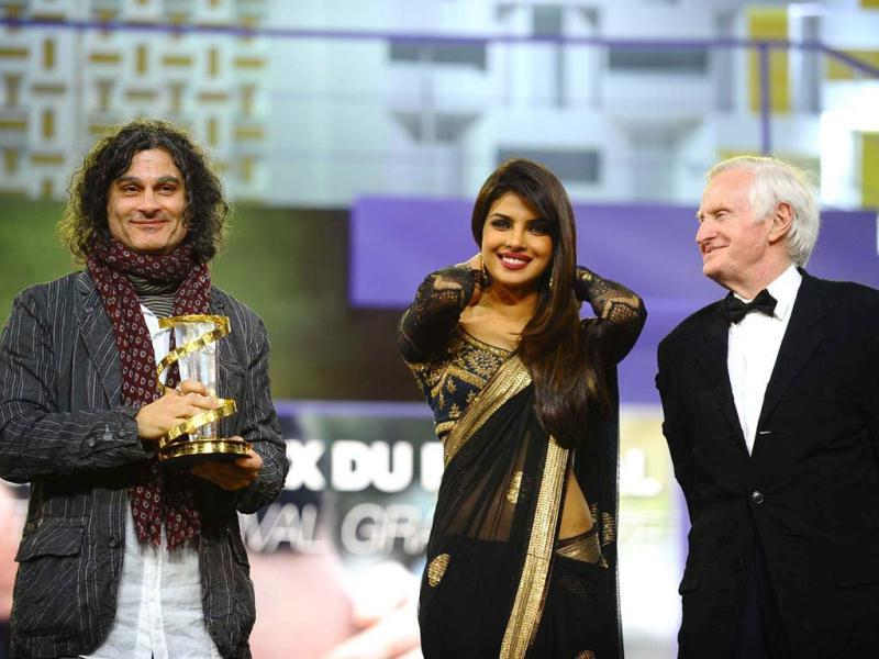 Lebanese director Ziad Doueiri poses with Priyanka Chopra and jury president and British film director John Boorman. (Photo/AP)