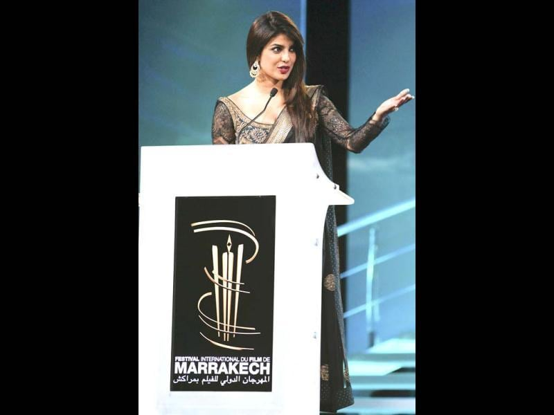 Priyanka Chopra speaks before awarding Lebanese director Ziad Doueiri with The Golden Star award, the festival's grand prize, for his film The Attack. (Photo/AP)