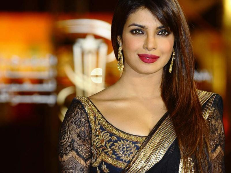 Priyanka Chopra opts for gold earrings and leaves her neck bare. Wise decision! (Photo/Reuters)