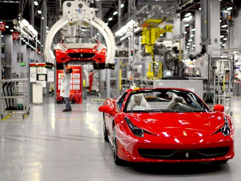 A Ferrari California is displayed at the end of the assembly line in the Ferrari factory in Maranello. The Ferrari 45 buildings's factory, where more than 3,000 workers produce the company's GT and Formula 1 cars is based in Maranello. AFP Photo