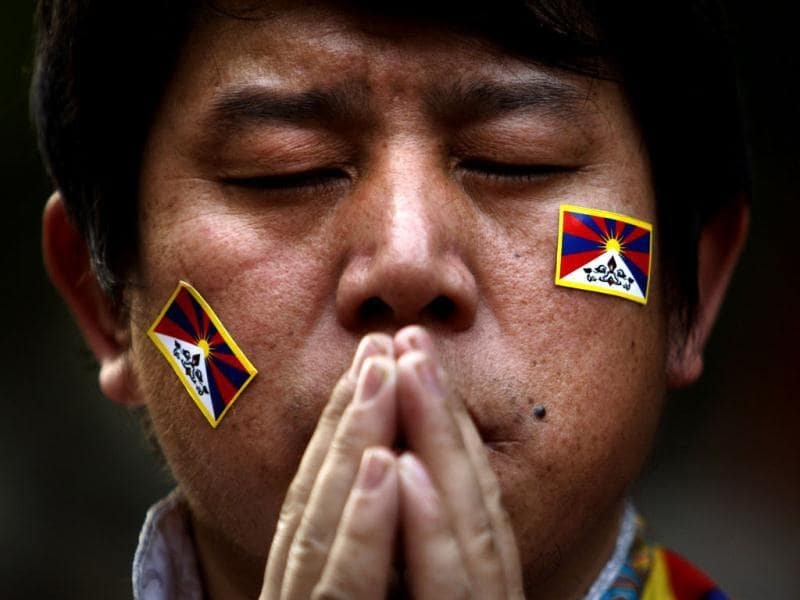 An exiled Tibetan Buddhist man prays during a rally to mark World Human Rights Day in New Delhi. At least 86 people have set themselves on fire since 2009. Tibetans also mark December 10 as the Nobel Peace Prize Day, the day the Dalai Lama received the Nobel peace prize in 1989. (AP Photo/Tsering Topgyal)