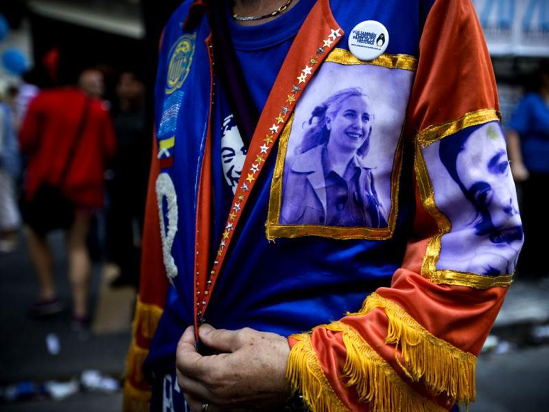 An activist wears a jacket with photos of late revolutionary leader Ernesto