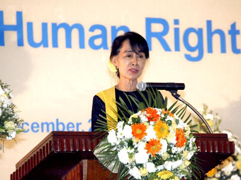 Myanmar opposition leader Aung San Suu Kyi speaks during a ceremony to mark International Human Rights Day in Yangon, Myanmar. (AP Photo/Khin Maung Win)