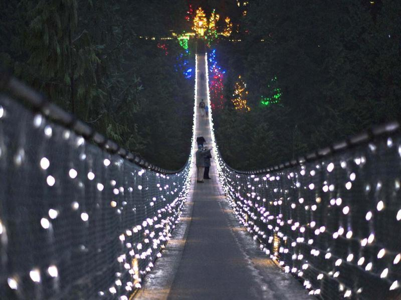 Visitors walk across the Capilano Suspension Bridge decorated in Christmas lights in North Vancouver, British Columbia. Reuters Photo
