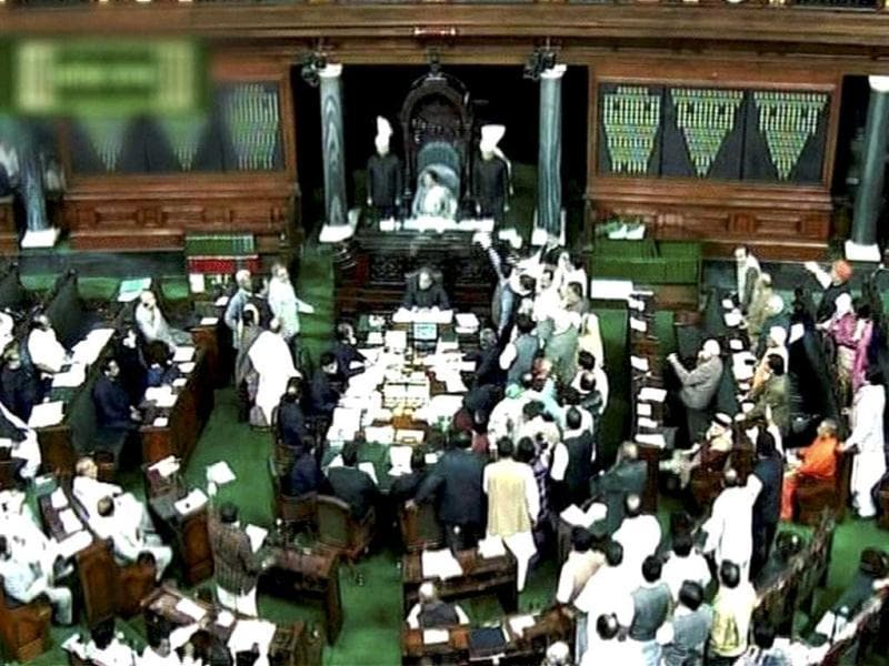 A scene in Lok Sabha in New Delhi:BJP members shouting slogans, demanding suspension of the question hour. The issue of Walmart lobbying to open the way for FDI in retail rocked both houses of Parliament as the Opposition demanded probe into the matter. (PTI Photo)