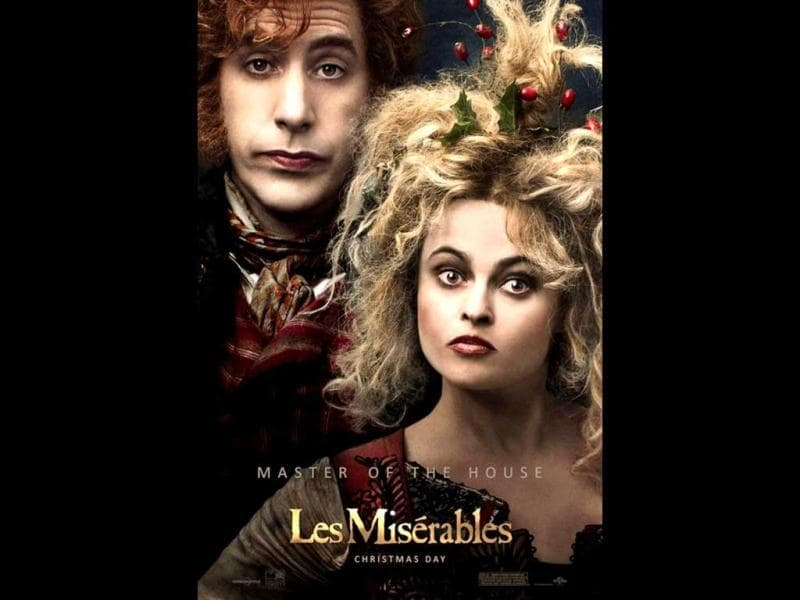 Sacha Baron Cohen and Helena Bonham Carter play the exaggerated characters of Thénardier and Madame Thénardier in Les Miserables.